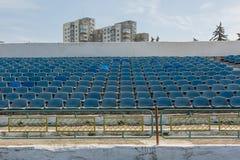 Old stadium tribune. Industrial architecture shot with empty old stadium blue tribune Royalty Free Stock Photo
