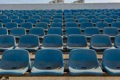 Old stadium tribune. Industrial architecture shot with empty old stadium blue tribune Royalty Free Stock Images