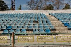 Old stadium tribune. Industrial architecture shot with empty old stadium blue tribune Stock Photo