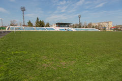 Old stadium tribune. Industrial architecture shot with empty old stadium blue tribune Stock Photography