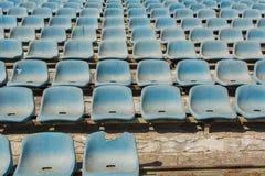 Old stadium tribune. Industrial architecture shot with empty old stadium blue tribune Royalty Free Stock Photography