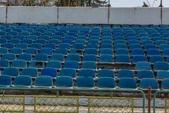 Old stadium tribune. Industrial architecture shot with empty old stadium blue tribune Stock Image