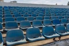 Old stadium tribune. Industrial architecture shot with empty old stadium blue tribune Stock Photos
