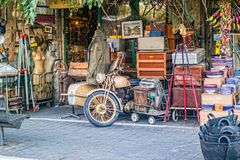 Old staff at entry to antiquities shop at Jaffa flea market.