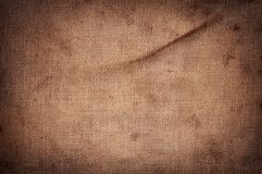 Old stained brown horizontal creasy burlap texture. Old stained brown horizontal creasy burlap texture Stock Photography