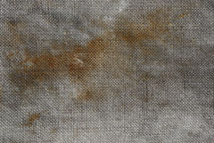 Old stained canvas. Closeup of old stained wet tarpaulin as a background Stock Images