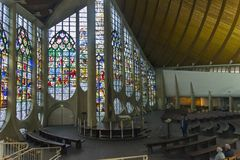 Old stained glass windows in a modern catholic church. royalty free stock image