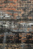 Old Stained And Painted Brick Wall Background Royalty Free Stock Images