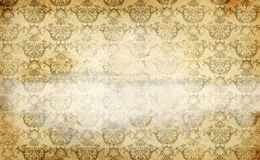 Old stained paper background with vintage ornament. Royalty Free Stock Photo