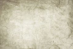 Old stained paper with dark borders. Old crumpled paper sheet background or texture stock images