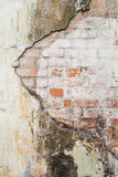 Old and stained platered wall and brick wall Stock Photo