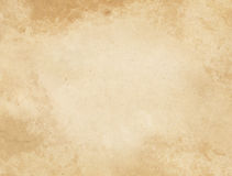 Old stained and yellowed paper texture. Aged yellowed paper background for the design Stock Photos