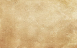 Old stained and yellowed paper texture. Aged dirty and yellowed paper background for the design Royalty Free Stock Images
