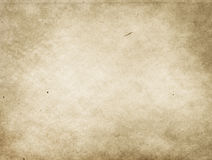 Old stained and yellowed paper texture. Yellowed dirty paper background. Natural old paper texture for the design Royalty Free Stock Photography