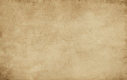 Old stained and yellowed paper texture. Grunge yellowed paper background for the design Stock Photography