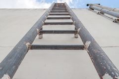 Old stair industrial metal rust  up to  water tank Royalty Free Stock Photo