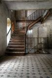 Old staircase in an abandoned hall Stock Photos