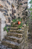 The old staircase decorated with plants in flower pots in the picturesque village of Mirabel Ardèche, France. Stock Photo