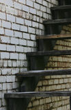 Old Staircase and Wall. Close-Up of old staircase and wall in an abandoned building Royalty Free Stock Photo