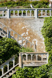 Old stairs of alcatraz with ingrowing green bushes Royalty Free Stock Images