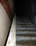 Old Stairs leading to a dark alley. Old painted stairs going up into the darkness. Dark back alley way. Not knowing what is on the other side Stock Image