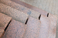 Old stairs made of red granite Stock Photography