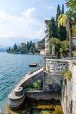 Old stairs on shore of Lake Como. Villa Monastero, Varenna, Italy royalty free stock image
