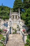 Old stairs on shore of Lake Como. Villa Monastero, Varenna, Italy stock image