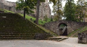 Old stairs and stone arch under ruins of castle in Cesis town, Latvia.  Royalty Free Stock Images