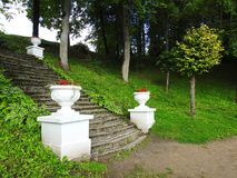 Old stairs in Sveksna town park, Lithuania royalty free stock image