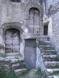 Old stairs to wooden doors in Italian Village Royalty Free Stock Images