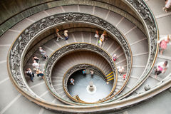 The old stairway inside the Vatican museums. With moving people in Rome, Italy stock images