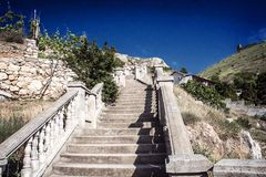Ladder to the sky. An old stairway in the mountains Royalty Free Stock Image