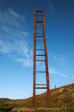 Old stairway to sky. An old and rusty staircase rises to the sky Stock Photos