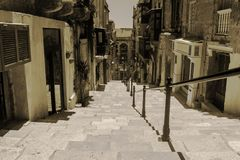 Old Stairway in Valletta, Malta. An Old Stairway in Valletta, Malta in monochrome and sepia Royalty Free Stock Photo