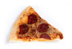 Old stale pizza slice isolated against white royalty free stock photography