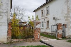 Old Stalinist house with a leaning fence stock image