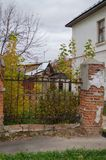 Old Stalinist house with a leaning fence royalty free stock image