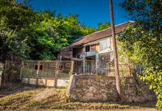 Old stall in Serbian village, HDR photo. Old stall in Serbian village. Endangered agriculture, abandoned houses. Poor depressed area. HDR photo Stock Photo