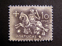 Old Stamp (Knight Templar). Portuguese old stamp with a night templar with shield and sward Stock Images
