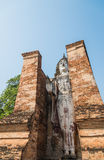 Old stand buddha statue in the ancient temple Thailand Stock Photo