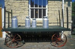 An old standard gauge steam engine car holds antique milk cans in Eureka Springs, Arkansas Royalty Free Stock Photos