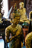 Old standing buddha image statue with Friday posture covered by gold leaf, Asokaram temple, Samutprakarn Royalty Free Stock Images
