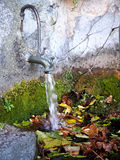 Old standpipe with a water jet Stock Image