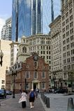 Old State House 2. Boston, Massachusetts USA - 2013 - Tourists and the historic Boston Old State House surrounded by the more modern buildings of the financial Stock Image