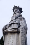 Old statue. Statue of Alexander the Good (Voivode of Moldavia between 1400 and 1432) holding the church of Bistrita monastery, in Romania royalty free stock images