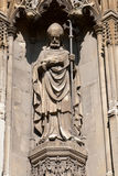 Old statue of a bishop. Statue of a bishop holding a scepter made in stone in Canterbury royalty free stock photo