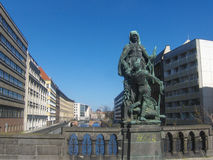 Old statue on a bridge over a river in Berlin, Germany Stock Photos