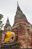 The Old Statue buddha and Pagoda. Statue buddha and Pagoda at Wat Yai Chaimongkol Ayutthaya ,Thailand Royalty Free Stock Image