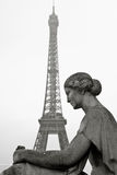 Old statue with Eiffel Tower in the background in Paris, France, Stock Image